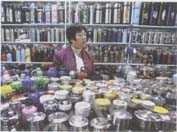 October 1 9, 2006: A storekeeper awaits customers at a retail market in Beijing. by Claro Cortes IV
