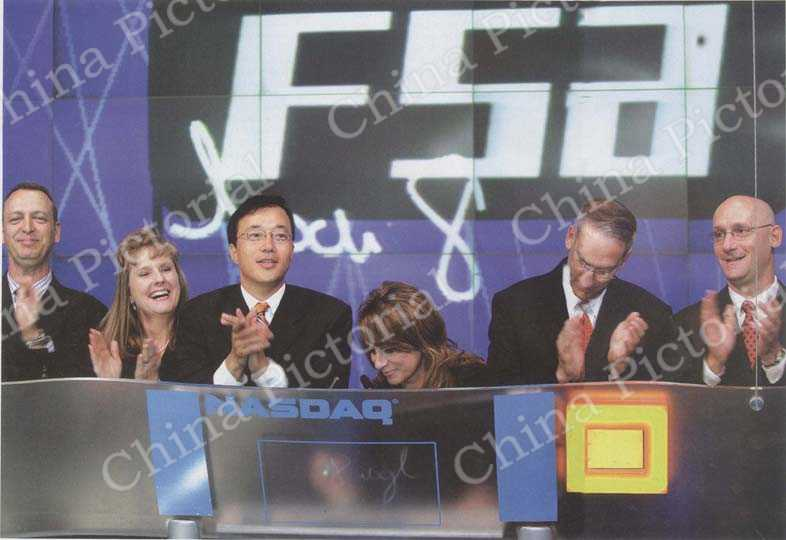 Deng Zhonghan particpated in the closing bell ceremony at the NASDAQ Exchange on July 27, 2006.